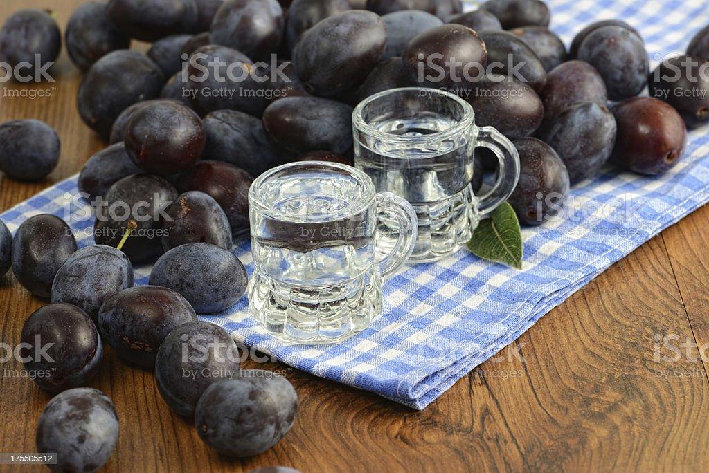 plum liquor in two short glasses stock photo