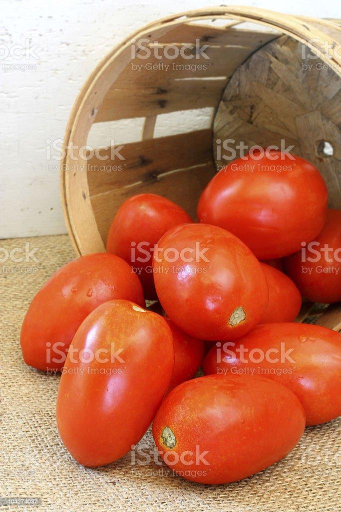 Plum tomatoes and farm basket stock photo