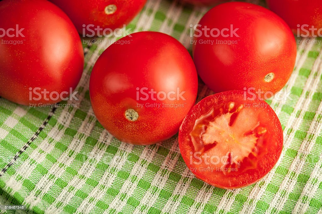 plum tomatoes on wooden rustic background stock photo