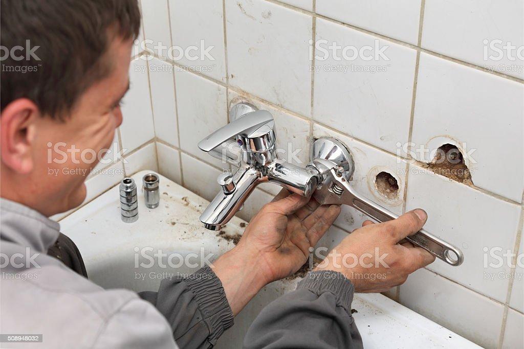 Plumber at work stock photo