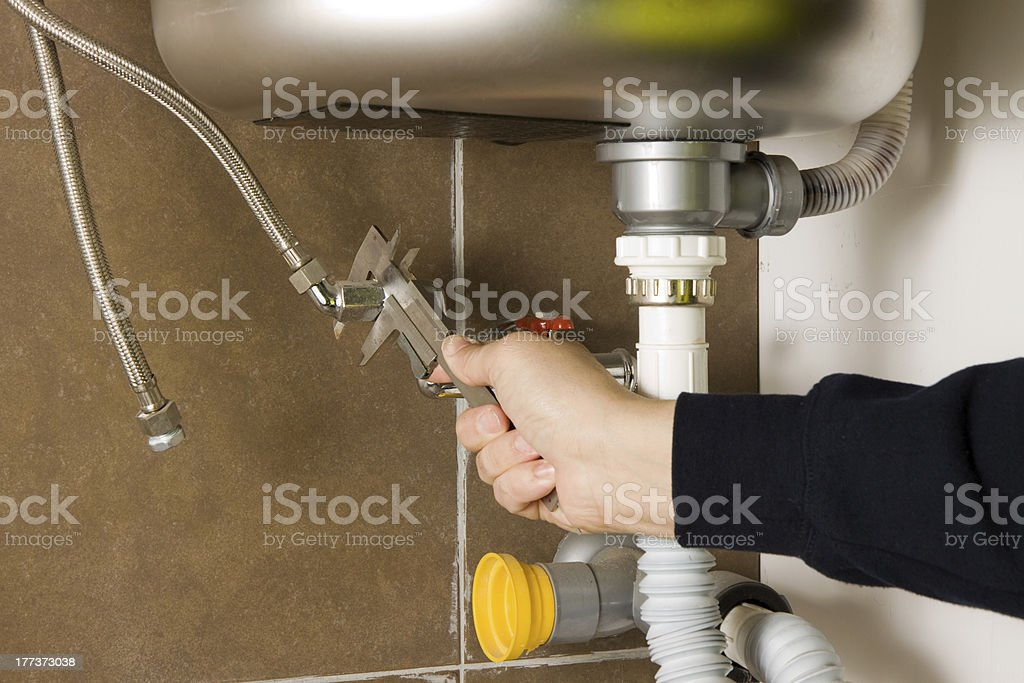 plumber at work with a sink royalty-free stock photo