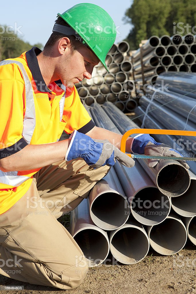 Plumber at work with pvc pipes. Sewage assembly. stock photo