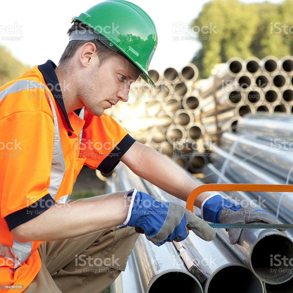 Plumber at work with pvc pipes. Sewage assembly. royalty-free stock photo