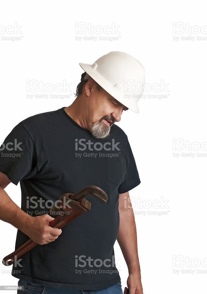 Plumber checks for leaks after a job royalty-free stock photo
