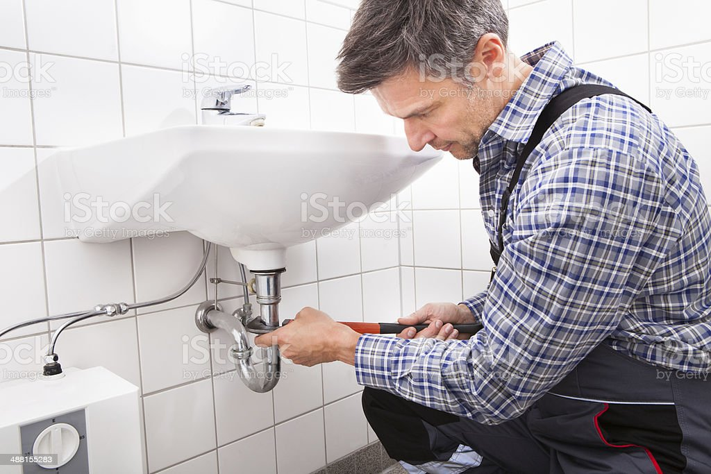 Plumber Fitting Sink Pipe stock photo