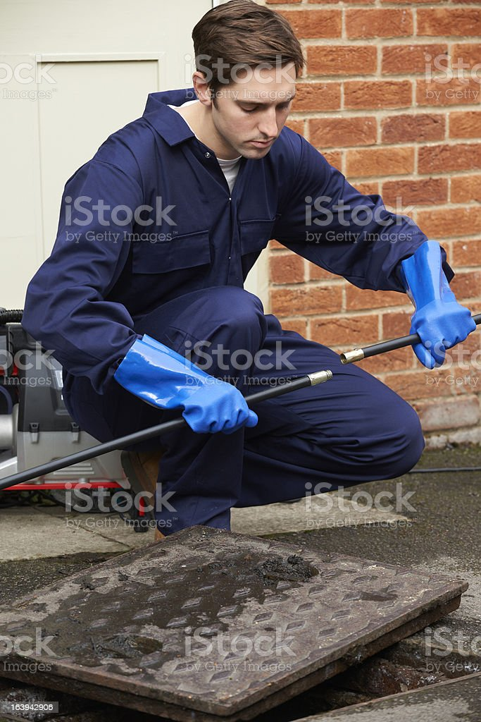Plumber Fixing Problem With Drains stock photo
