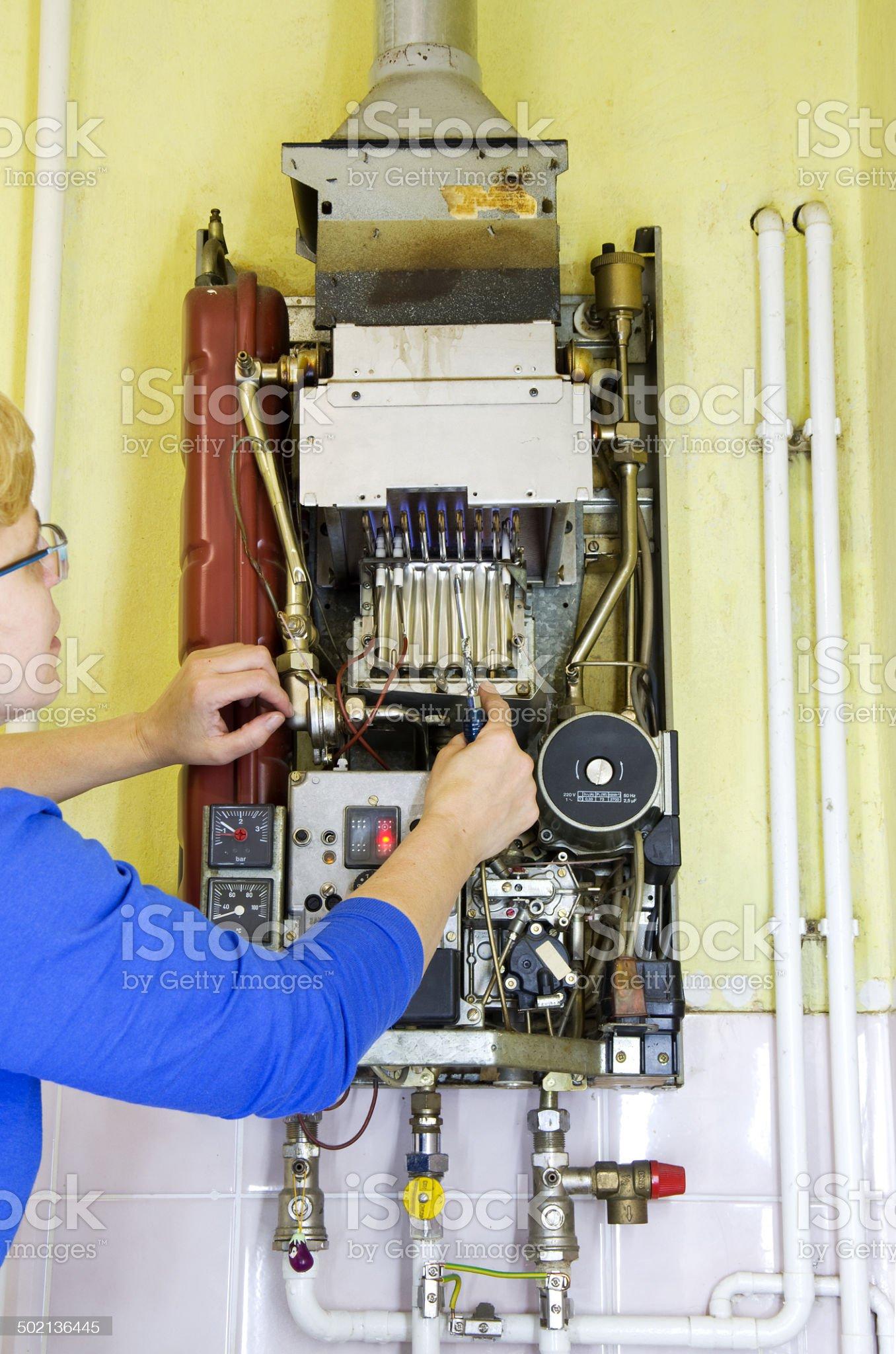 plumber heating screwdriver royalty-free stock photo