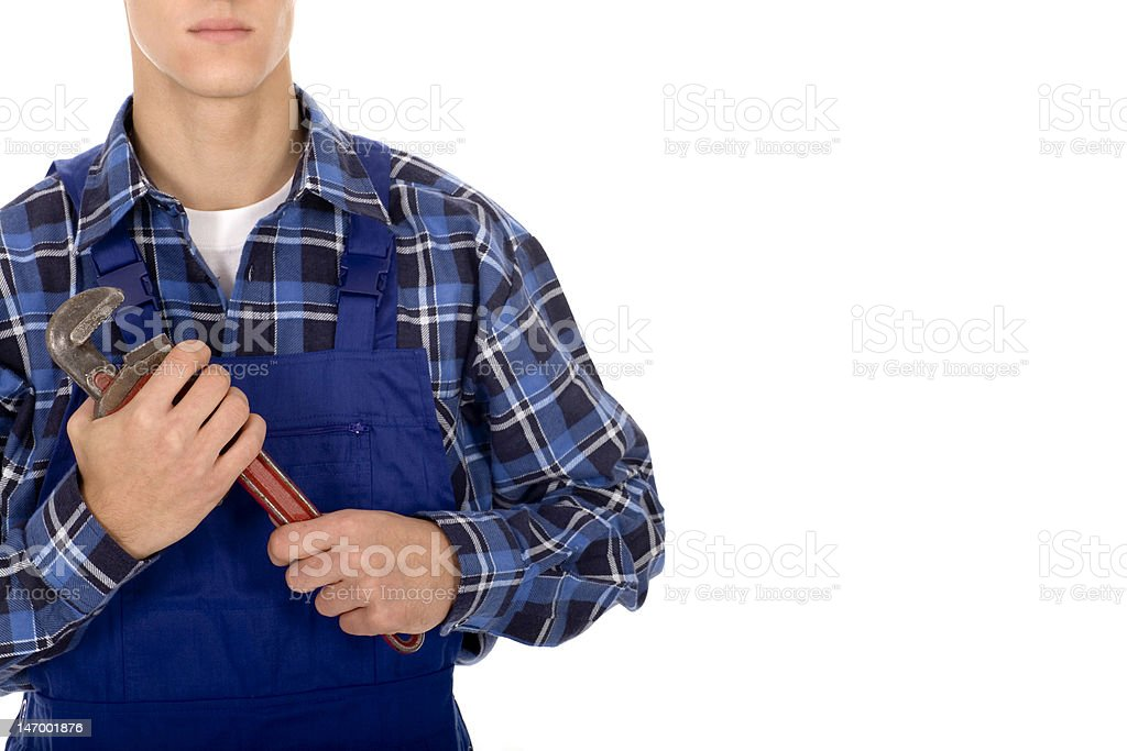 Plumber holding pipe wrench royalty-free stock photo