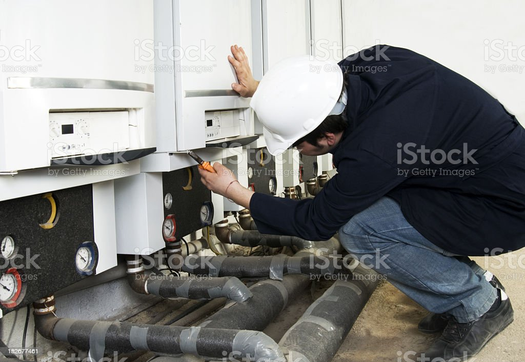 Plumber in the process of a repair royalty-free stock photo
