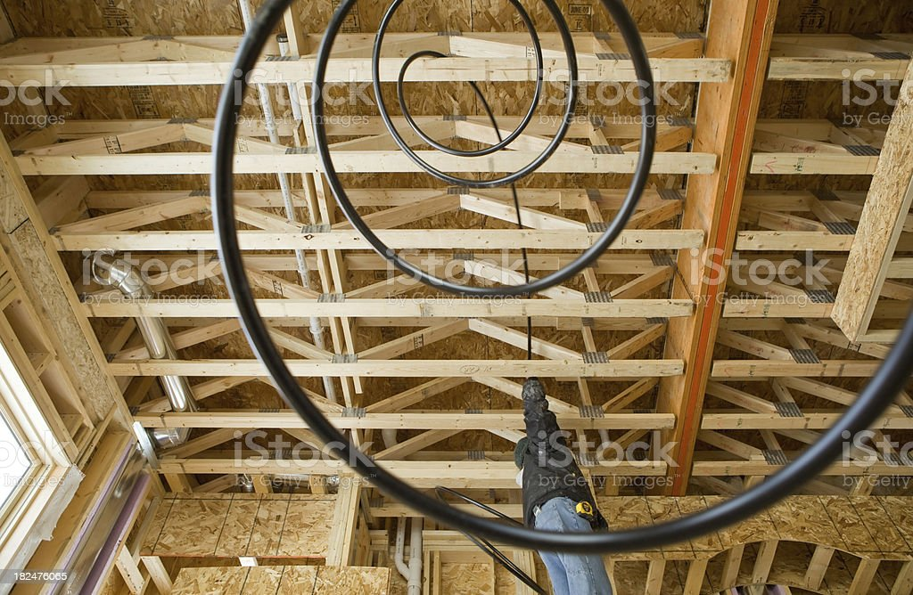 Plumber Installing Plastic Tubing in Home Construction Site stock photo