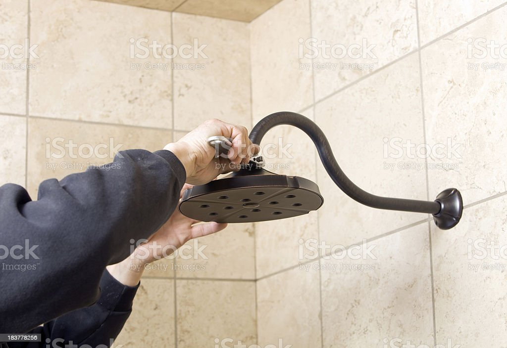 Plumber Installing Showerhead with Adjustable Wrench stock photo