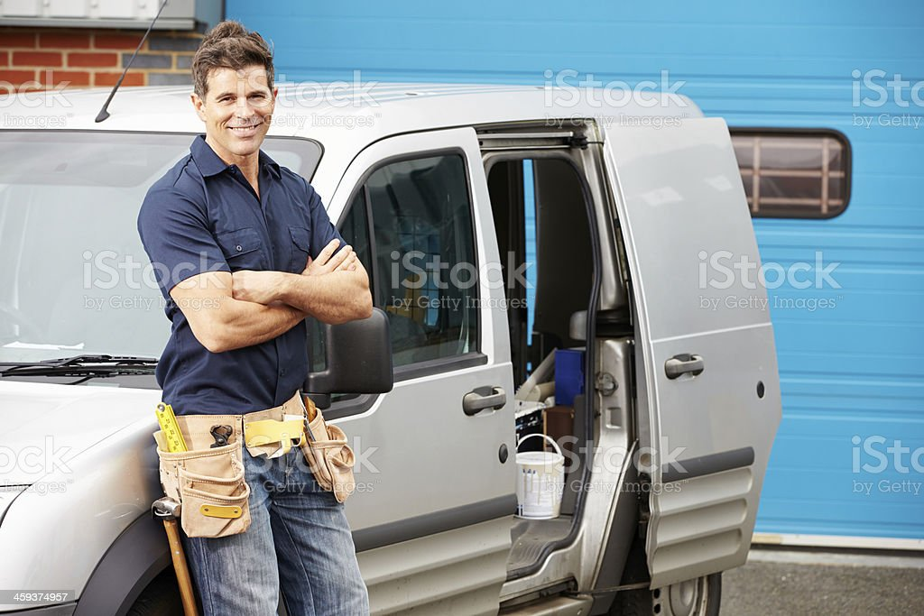 Plumber Or Electrician Standing Next To Van stock photo