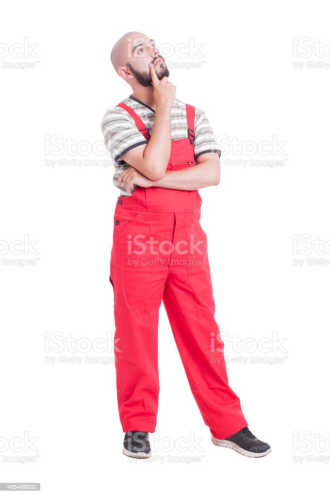 Plumber or mechanic  thinking and looking up stock photo
