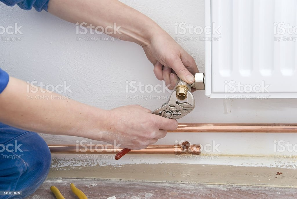 plumber radiator stock photo