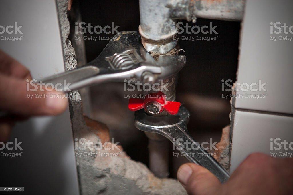 Plumber repair the valve stock photo