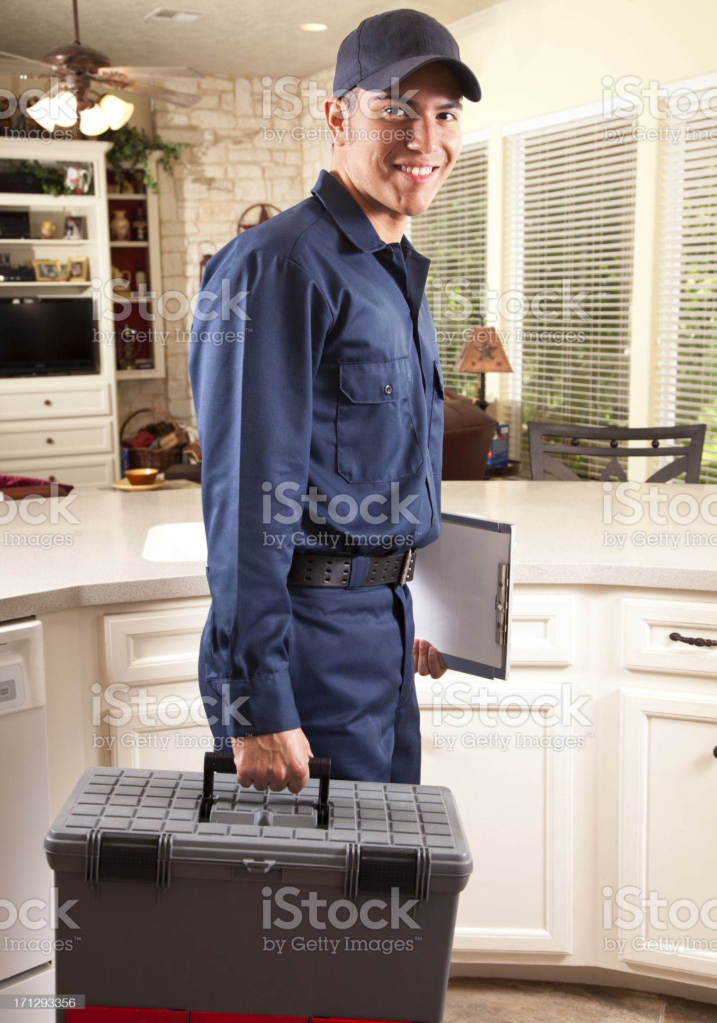 Plumber, repairman arriving in home domestic kitchen for service call. royalty-free stock photo