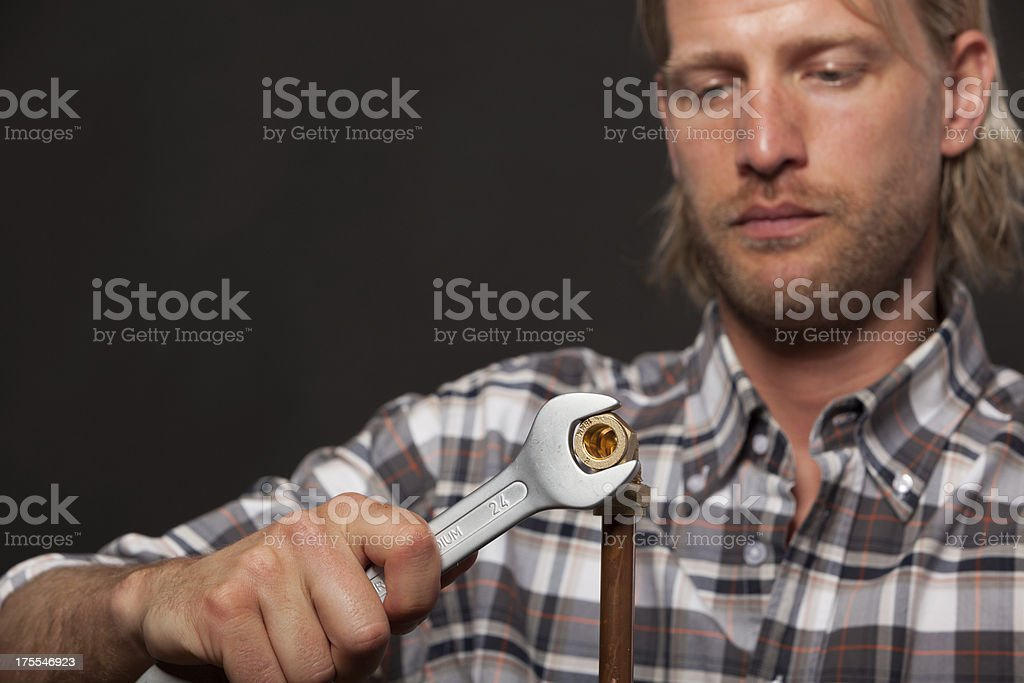 Plumber tightening compression fitting stock photo