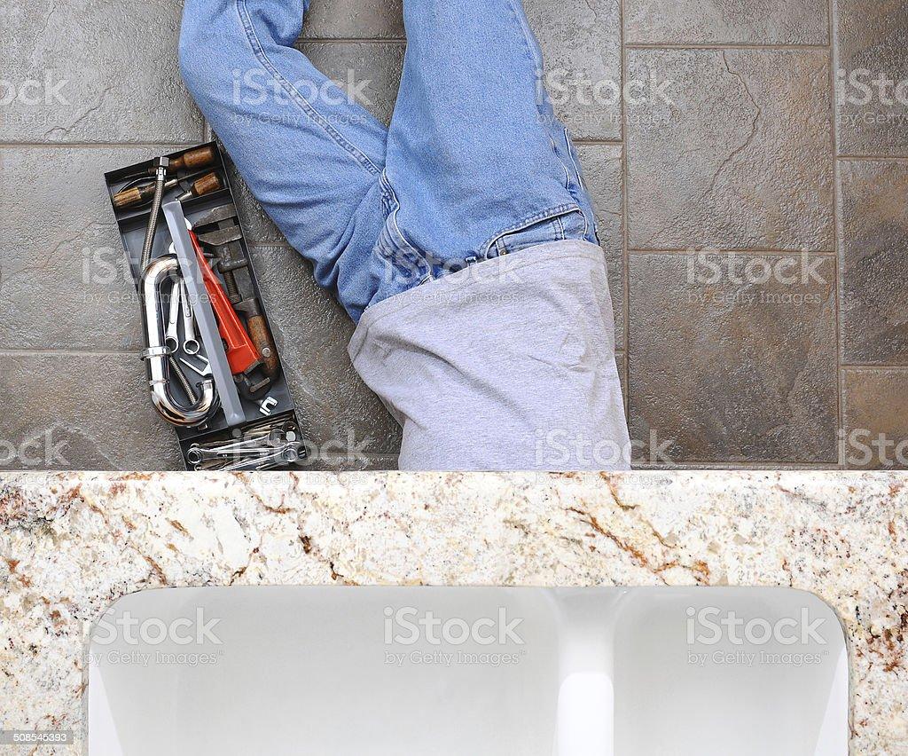 Plumber Under Sink stock photo