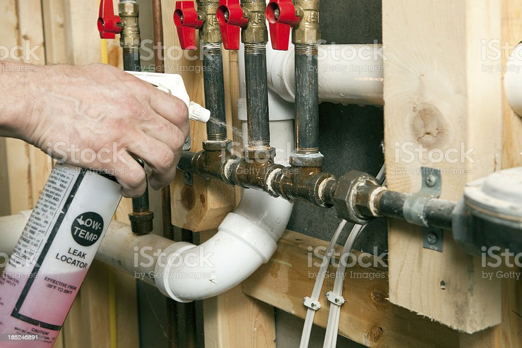 Plumber Using Leak Locator Spray on Gas Lines stock photo