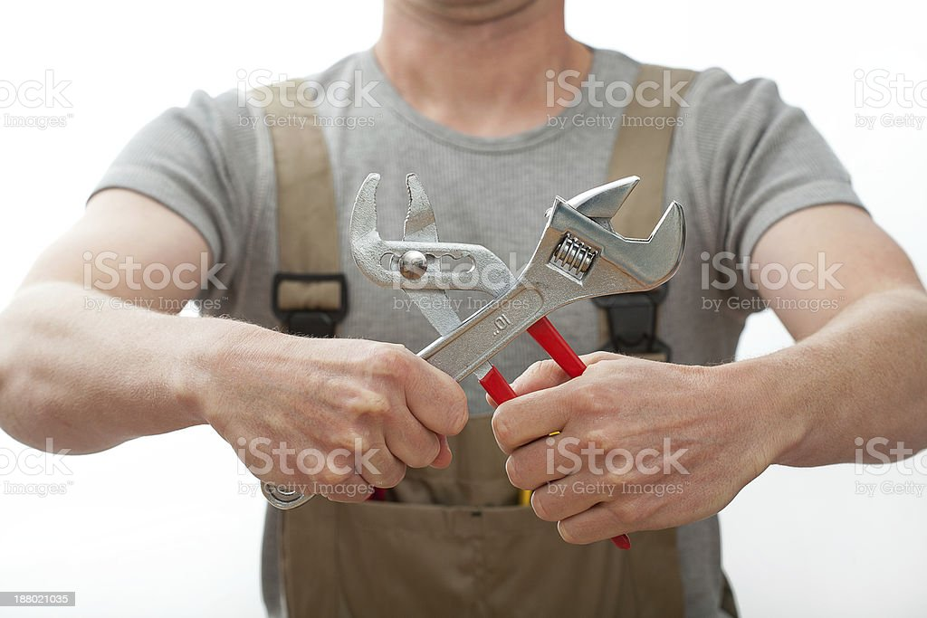 Plumber with tools stock photo