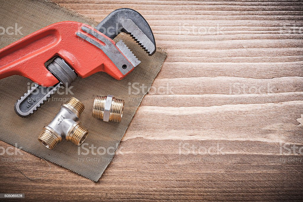 Plumbers wrench pipe fittings water mesh filter grid constructio stock photo