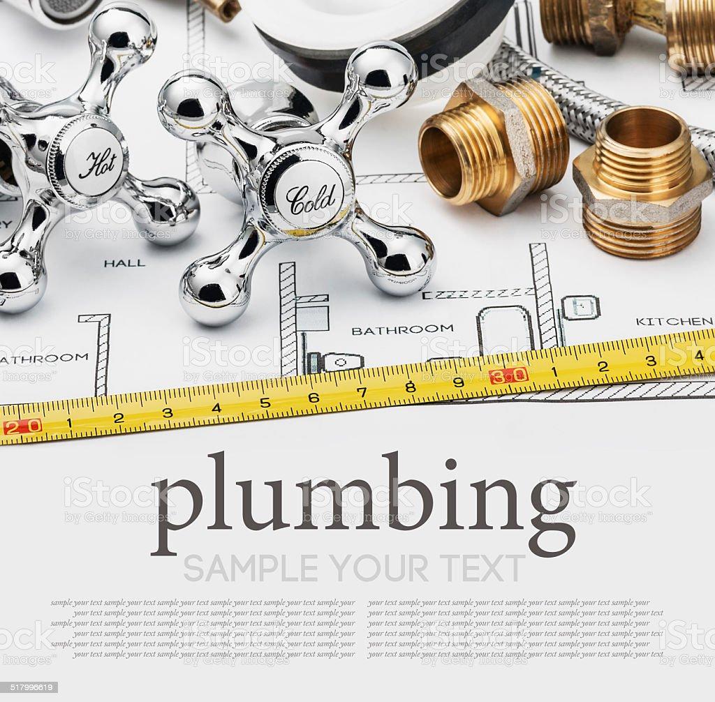 plumbing and tools lying on drawing stock photo