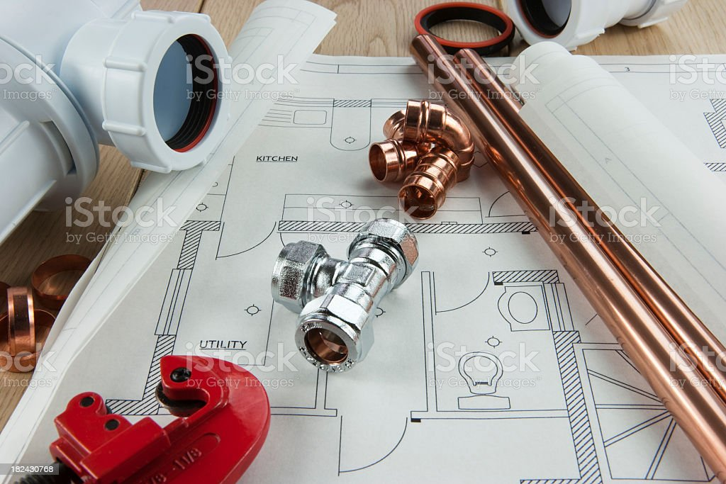 A plumbing diagram with copper pipe, tubing and fixings stock photo