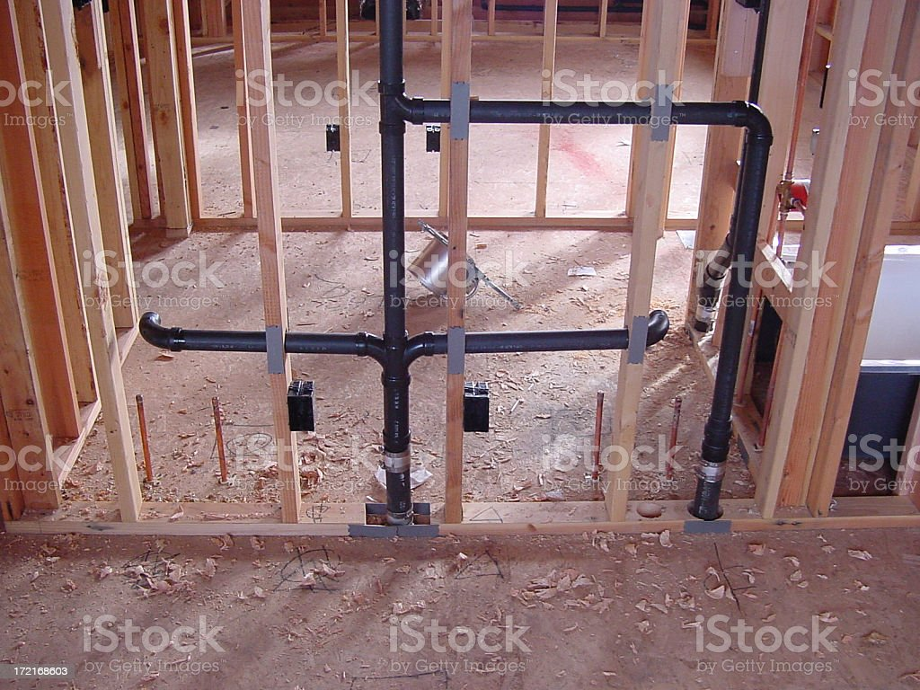 Plumbing in wall framing royalty-free stock photo