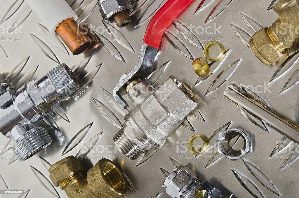 Plumbing Kit on a metal surface royalty-free stock photo