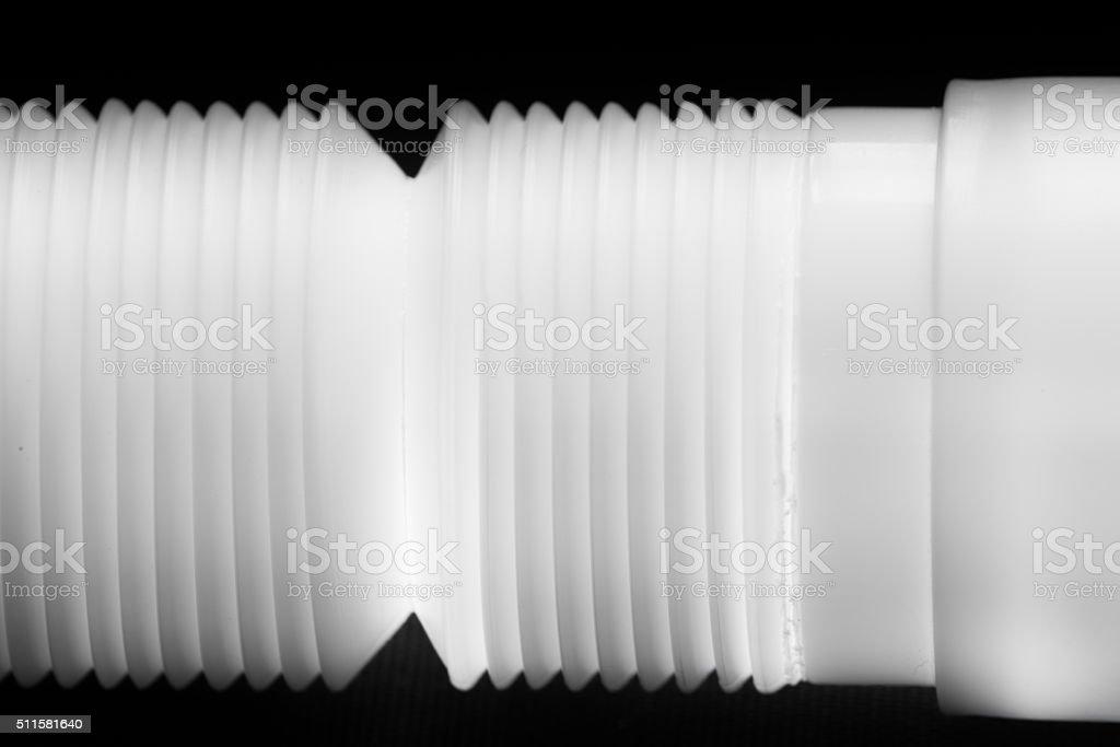 Plumbing the white plastic pipes stock photo