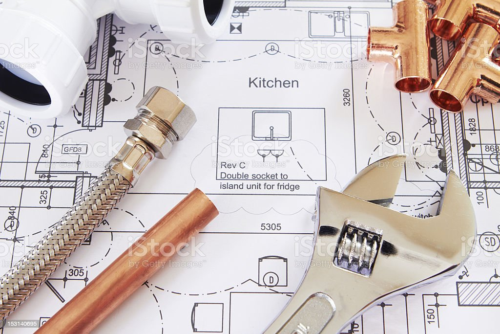 Plumbing Tools Arranged On House Plans stock photo