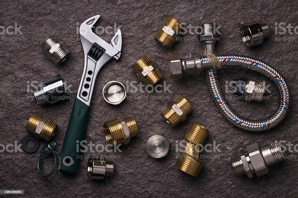 Plumbing tools for connecting water taps, top view stock photo