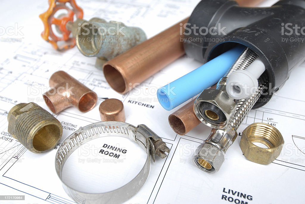Plumbing tools on a building design royalty-free stock photo