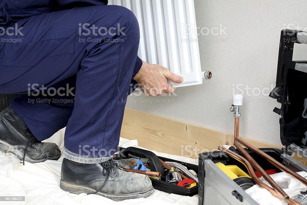 Plumbing work removing a radiator. royalty-free stock photo