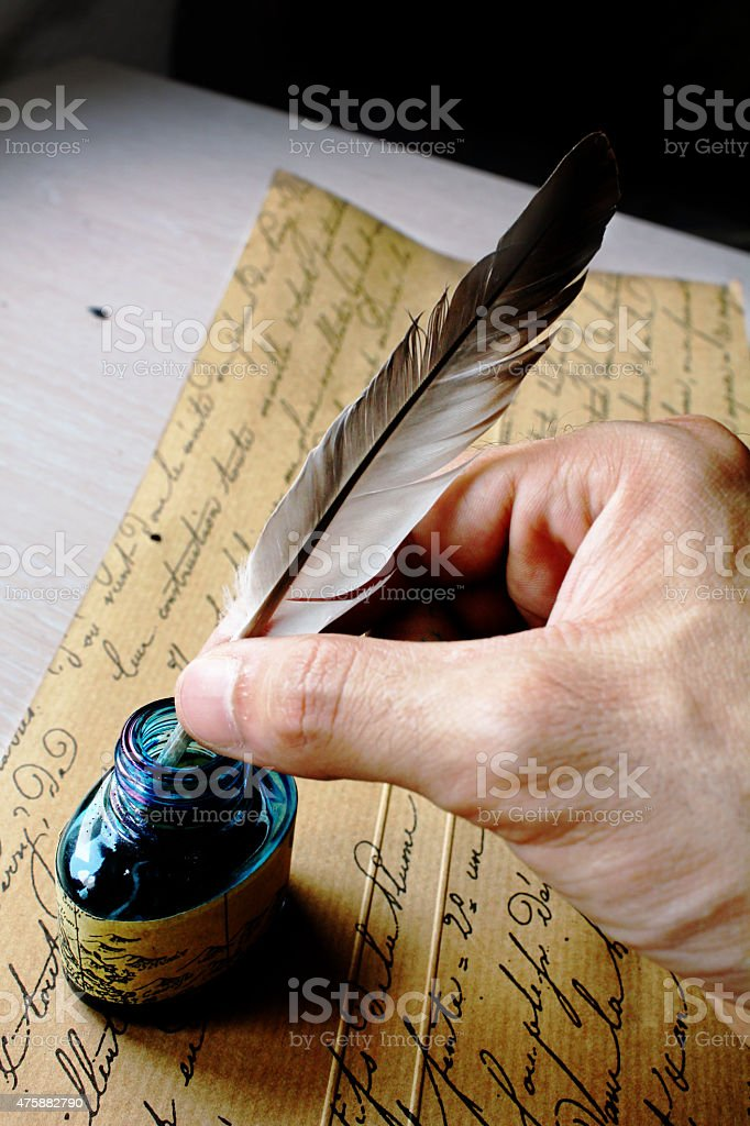 Plume and ink stock photo