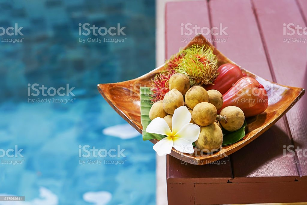 plumeria with welcome fruits near swimming pool stock photo