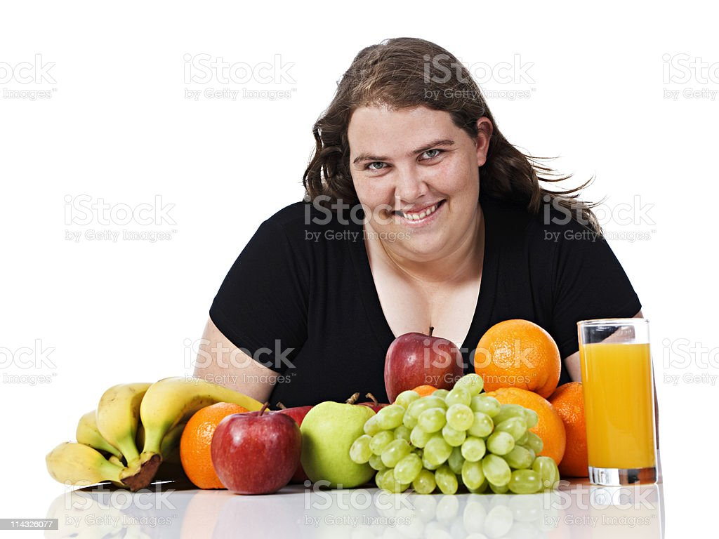 Plump smiling young woman happily eyes healthy food stock photo
