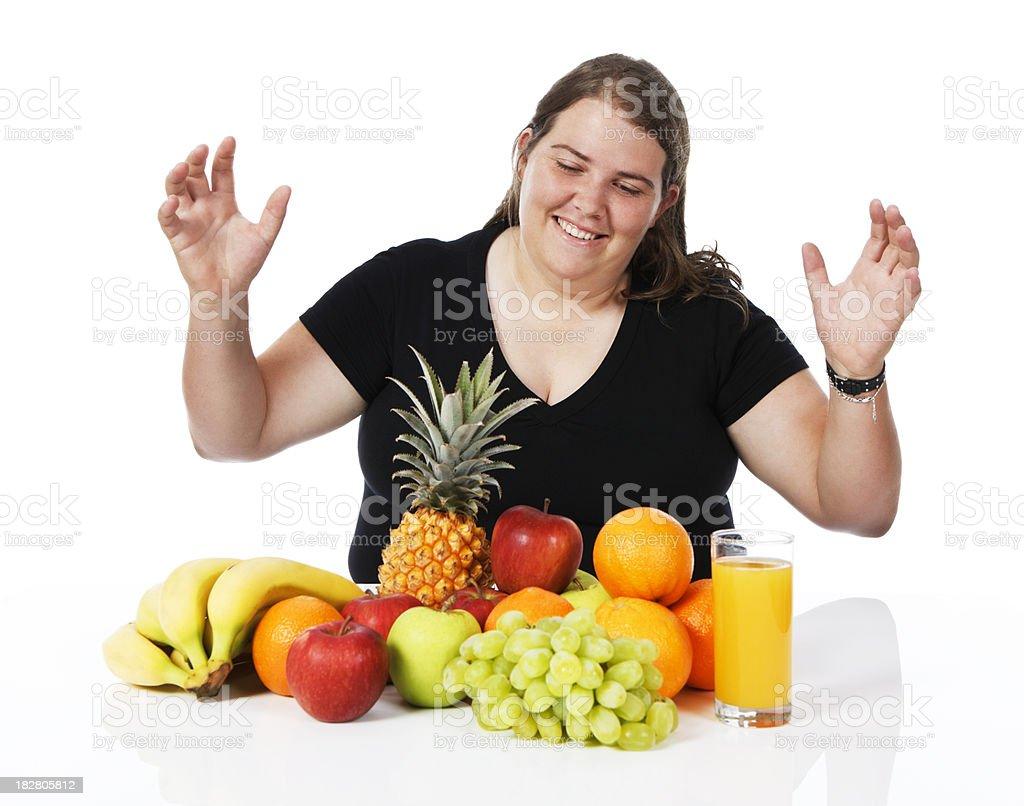 Plump woman is amazed at what she may legitimately eat stock photo