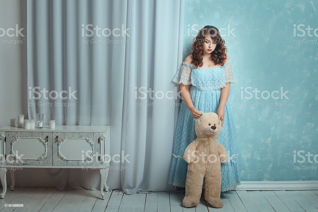 Plump woman lowered her head sadly. stock photo