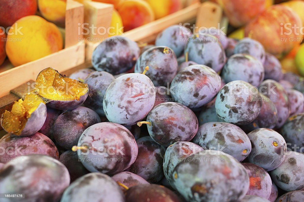 Plums and peaches at the market place royalty-free stock photo
