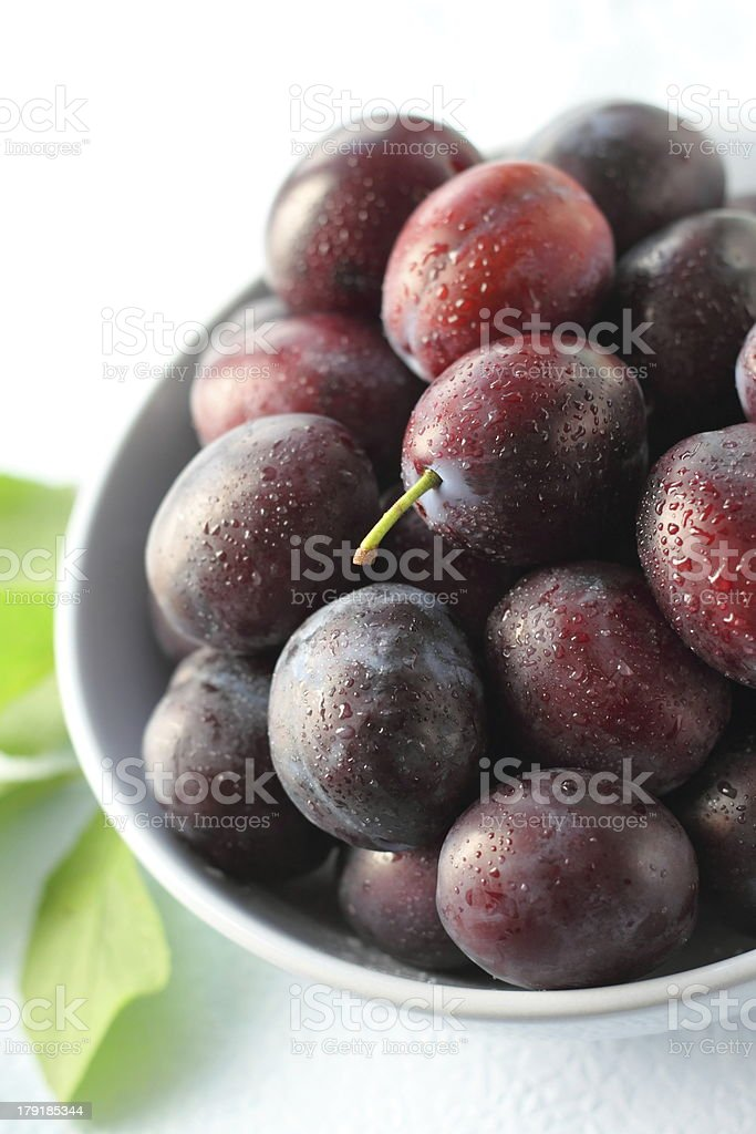 Plums in a bowl royalty-free stock photo