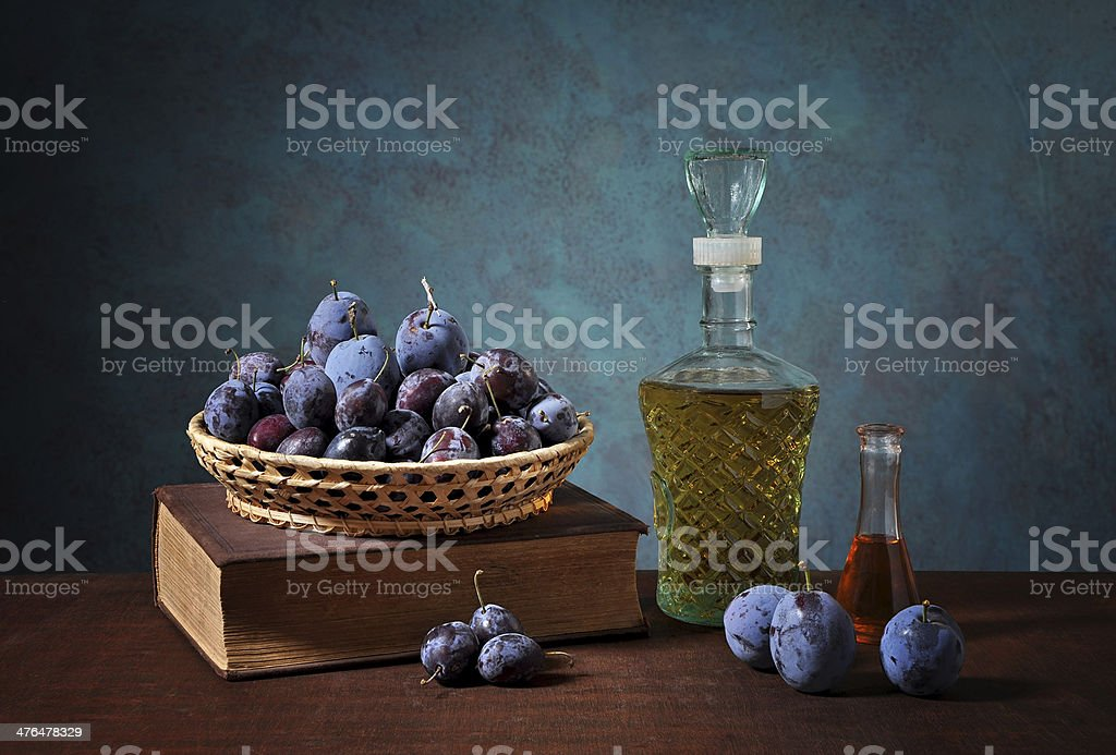 Plums in a wicker basket royalty-free stock photo