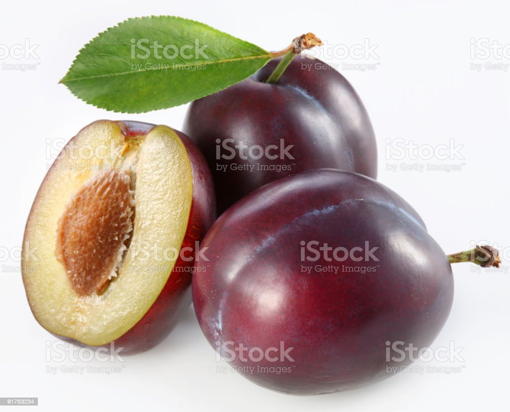 Plums on a white background stock photo