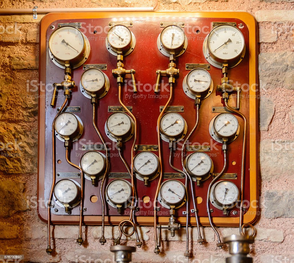 plurality of circular dials and gauges to measure precise control stock photo