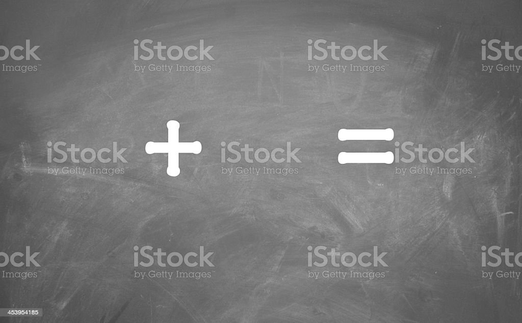 Plus and equal sign written on a chalkboard stock photo