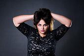 Plus size model in black lace dres, xxl woman portrait