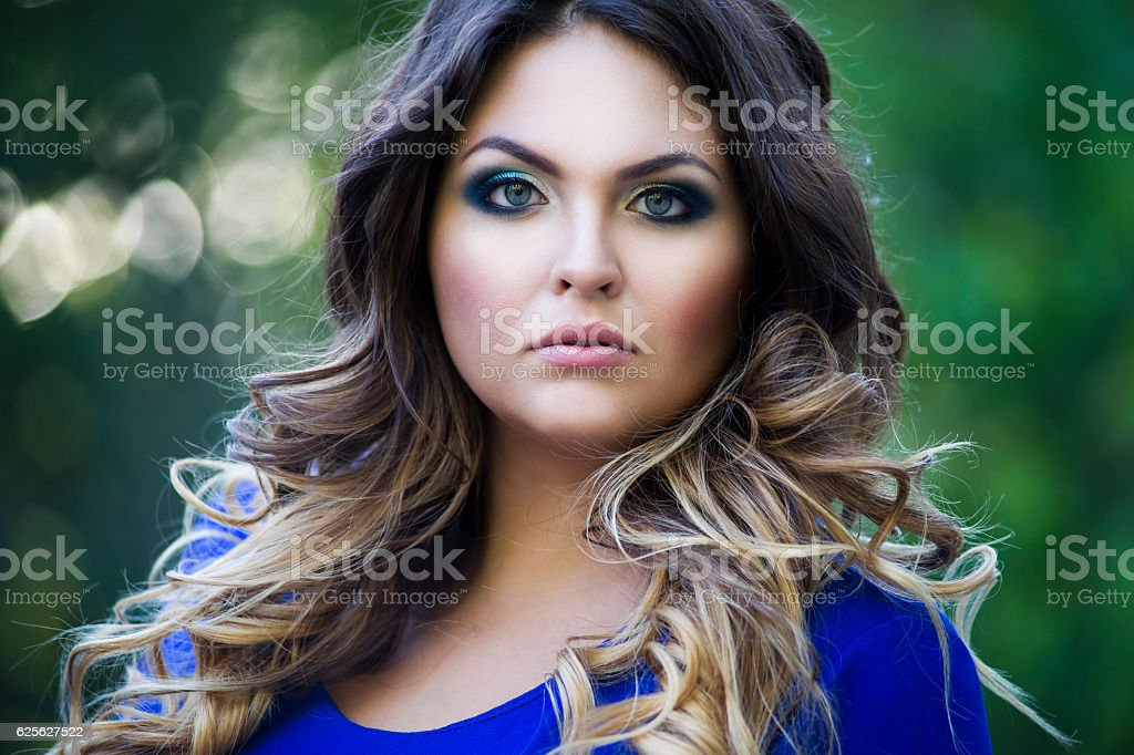 Plus size model, woman on nature, makeup and hairstyle stock photo