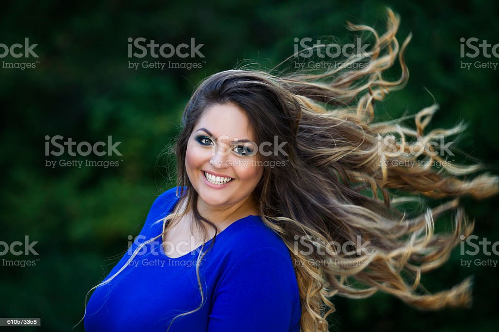 Plus size model, xxl woman with developing in wind hair stock photo