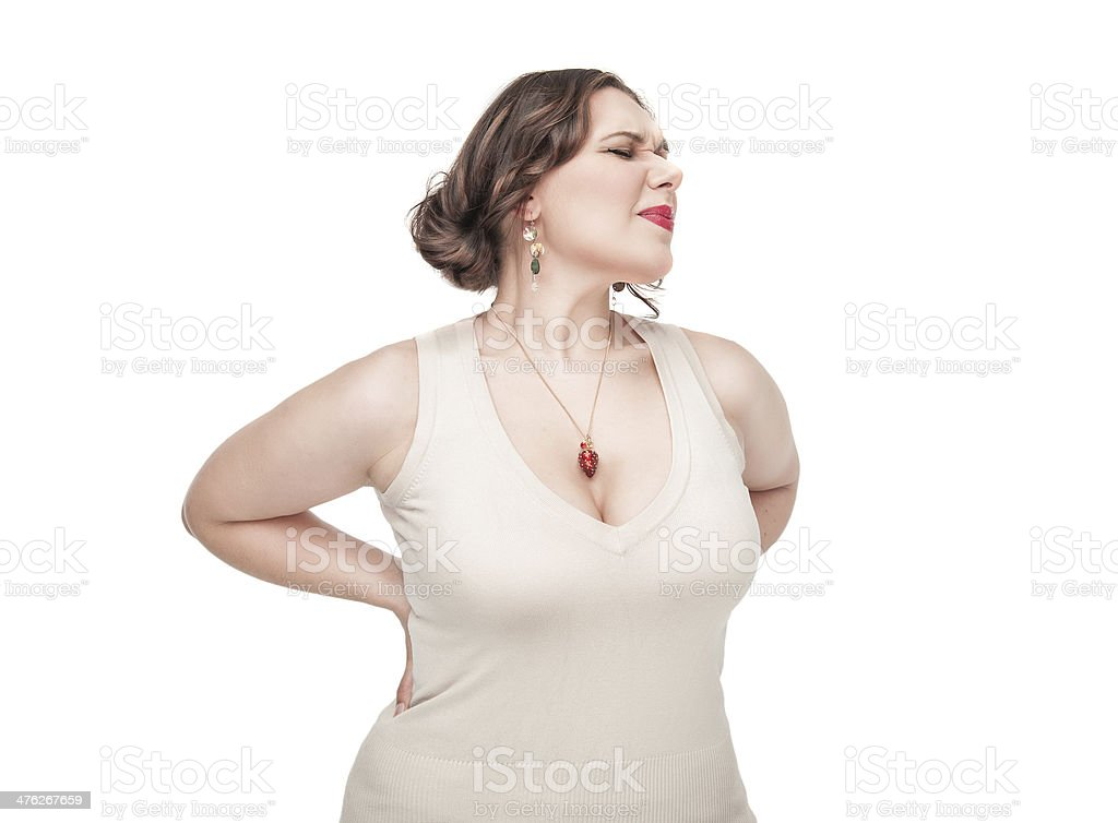 Plus size woman with pain in her back royalty-free stock photo