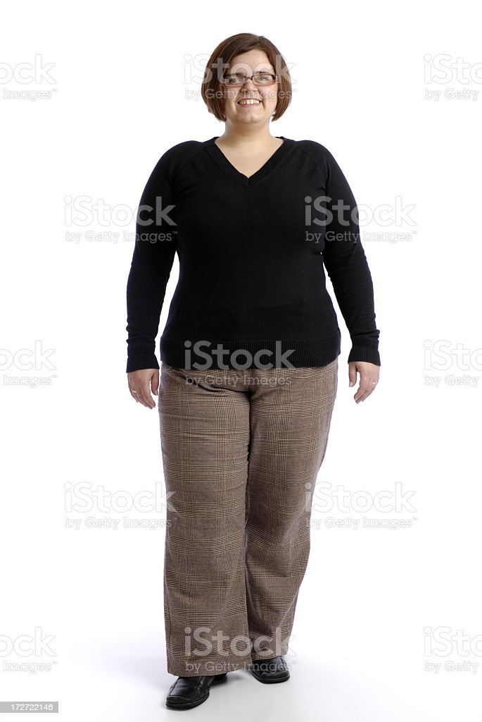 Plus sized woman in professional attire posing confidently royalty-free stock photo